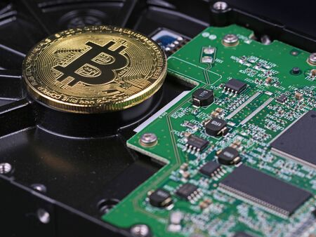 Bitcoin on hard drive, crypto currency digital money concept