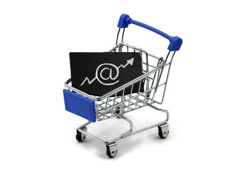 Shopping cart with email symbol in growing up arrow on white background, concept of shopping online and growing E-commerce