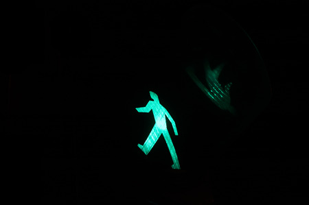 dont walk: Traffic lights with the green light lit Stock Photo