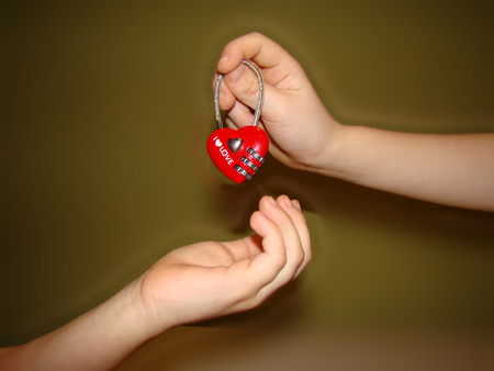 reciprocity: the feeling of love passed from hand to hand in the shape of a heart