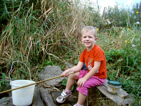 supplemental: child on the shore catch fish Stock Photo