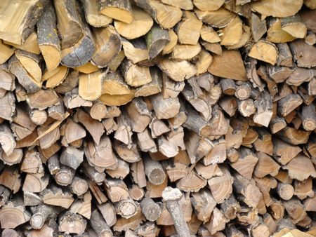 furnace: firewood choppedfolded.firewood for heating furnace in the winter. Stock Photo