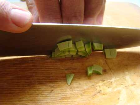 cutting vegetables: cutting vegetables into cubes with a kitchen knife for frying