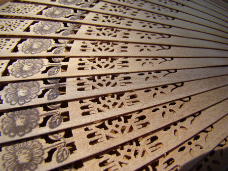 perforation: texture of the fan complex pattern thinly sliced wood folded in turn. Stock Photo
