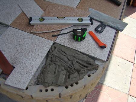 grout: tile laying,the process of laying the tiles on the floor,the grout for the tile.