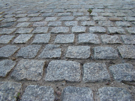 paving stones.the granite paving cubes.the durability of the material. Stock Photo