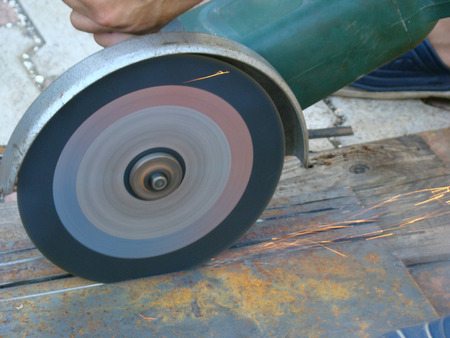 slag: Bulgarian saws metal cutting wheel,metal processing. Stock Photo