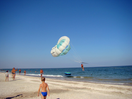 azov sea: parachute ride in the urban-type village Kirillovka on the Azov sea coast photo taken 31 July 2015.