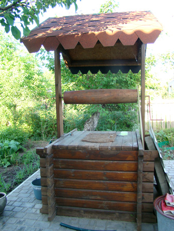 groundwater: well.the source of drinking water made of wood. Stock Photo