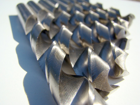 rotational: drill bit-cutting tool with rotational cutting movement. Stock Photo