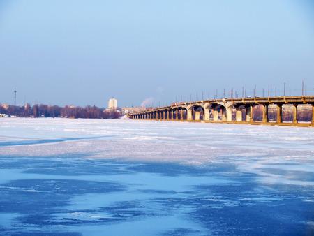across: Kiev,the bridge across the frozen river Dnieper.