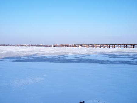 frozen river: Kiev,the bridge across the frozen river Dnieper.