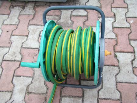 onto: garden garden hose wound onto the spool