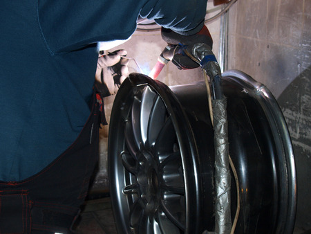 Argon-arc welding,titanium disk,repair Stock Photo