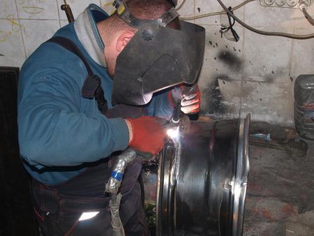 titanium: Argon-arc welding,titanium disk,repair Stock Photo