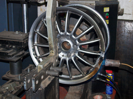 wheel balancing: alignment of drives on titanium straightening machine. Stock Photo