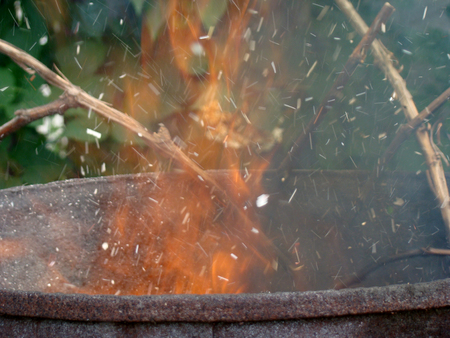 vegetative: burning of vegetative waste,metal barrels under the open sky Stock Photo