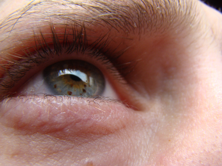 and eyelid: human eye looking into the distance in front of him Stock Photo