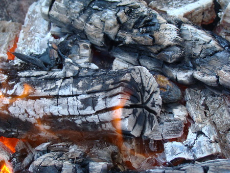 smoldering: wood in the fireplace burned down,the coals from the wood smoldering in the fireplace Stock Photo