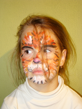 painted face: a beautiful little girl with painted face like a tiger Stock Photo