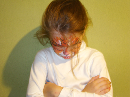 roleplaying: a beautiful little girl with painted face like a tiger Stock Photo