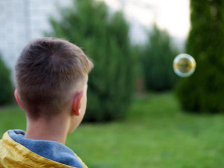 levitate: child blow bubbles with a pleasure Stock Photo