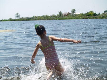 children swim and having fun in the river  Stock Photo
