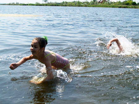 children swim and having fun in the river  Stock Photo