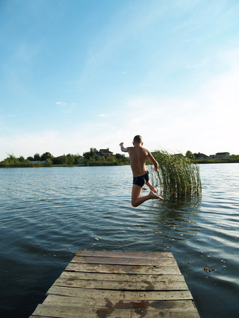 children swim and having fun in the river  写真素材