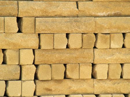 facing torn brick of yellow color Standard-Bild - 116640995