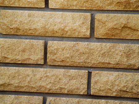 facing torn brick of yellow color