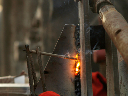 carrying out welding work with electric welding Stock Photo