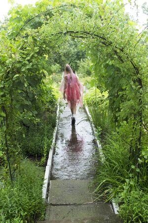 child in the rain in a raincoat Standard-Bild - 131914670