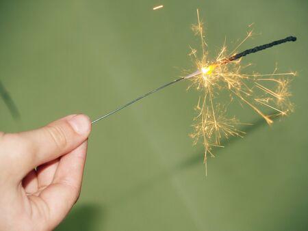 Sparkler burns and sparkles with bright sparks Standard-Bild - 136744557