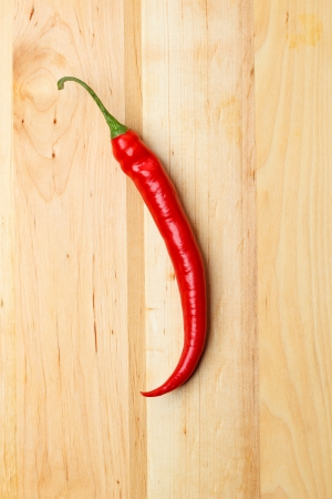 One chilli on table photo