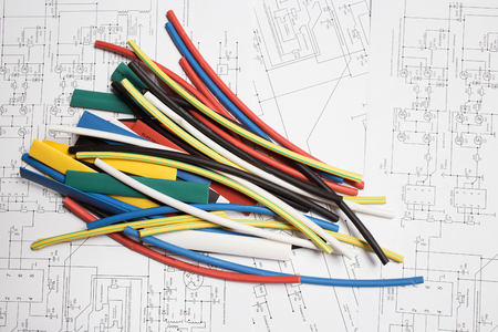 shrink: Colored heat shrink tubing lie on the wiring diagrams