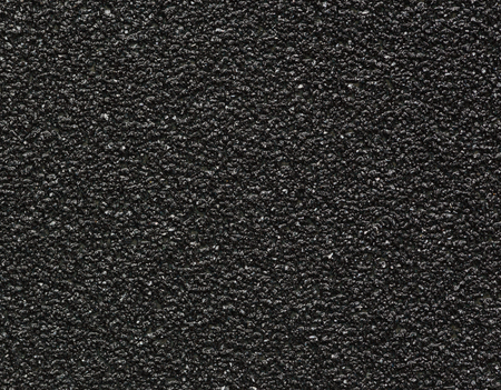 emery paper: Black sandpaper texture macro shot background