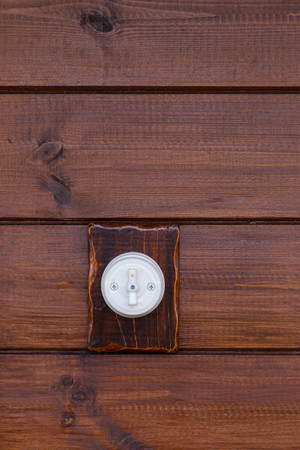 light switch: Retro light switch on wooden background Stock Photo