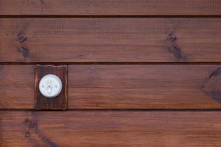bakelite: Retro light switch on wooden background Stock Photo