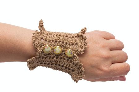 armlet: Knitted handmade brown bracelet isolate on white background Stock Photo