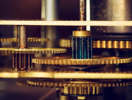 rackwheel: Retro gold gear wheels of a clockwork