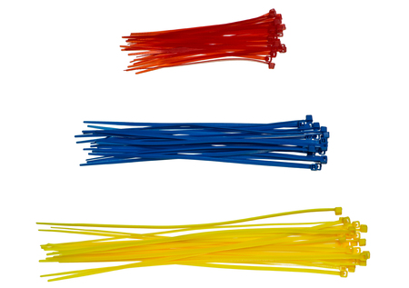 Three piles of cable ties red, blue and yellow color