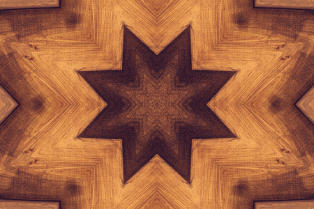 tantra: Kaleidoscope picture with brown star. Wooden background.