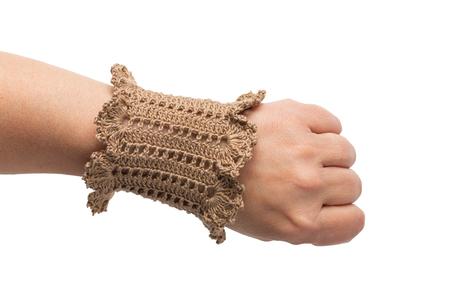Brown handmade band on womans hand