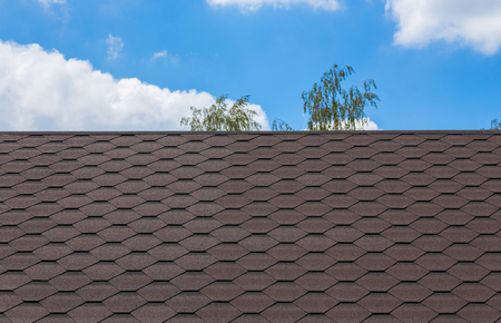 Part of texture with shingles roof and blue sky