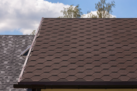 bitumen: Part of red bitumen tiles roof in sunny day