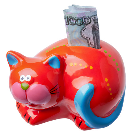 Piggybank for banknotes and coins in the form of a red cat with a bill of a thousand Russian rubles