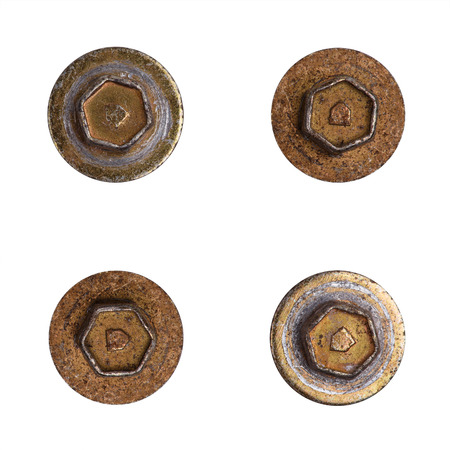 Four old screw heads isolated on white background. Screw heads with shim Stock Photo