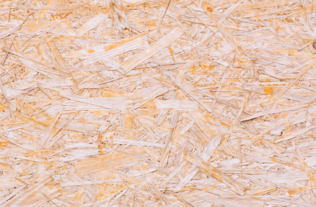 Macro shot of wood chipboard. Background from the pressed sawdust