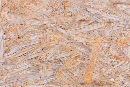 Background of pressed sawdust. Macro shot of wood particle board Stock Photo
